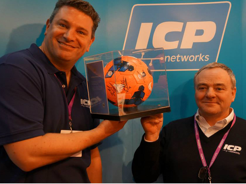ICP Networks MD Matt Archer and Bob Greaves with a signed Manchester City and Chelsea match ball