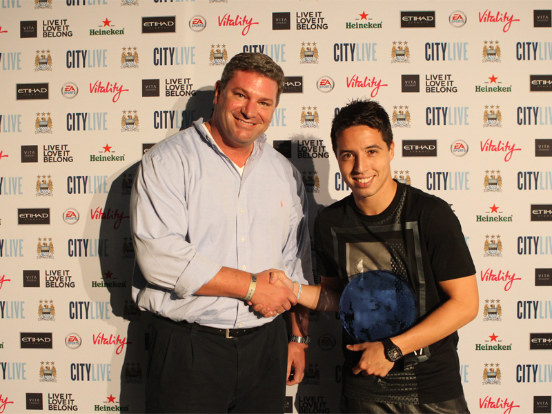 ICP Networks MD Matt Archer presents Manchester City star Samir Nasri with his Goal of the Season Award at City Live